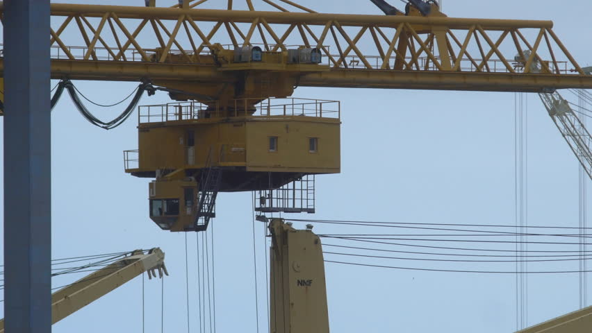 Detail of cranes moving at a container port in Palermo | Shutterstock HD Video #1011402821