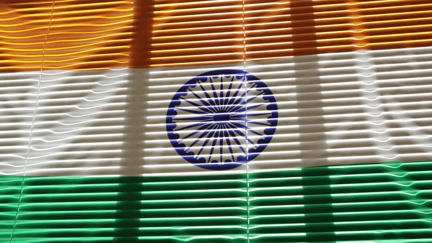 Indian flag is moving from the blowing draft at jalousie window in sunny day. | Shutterstock HD Video #1011412241