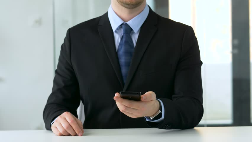 Business and technology concept - businessman working with smartphone at office | Shutterstock HD Video #1011463661