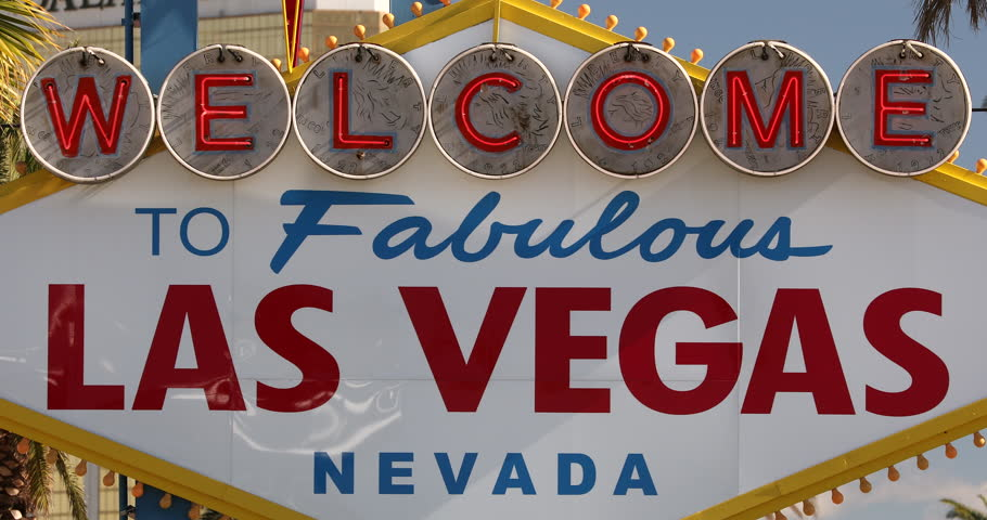 Welcome to Las Vegas neon road marker sign in Nevada.  Las Vegas is know for its casino gambling, night life entertainment and the tourist vacation hotels on the strip. | Shutterstock HD Video #1011482771