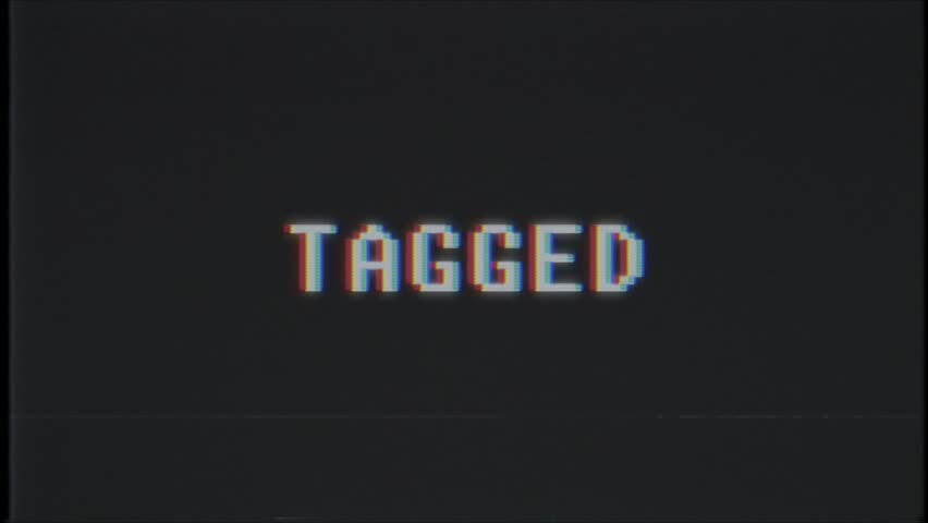 Retro videogame TAGGED word text computer tv glitch interference noise screen animation seamless loop New quality universal vintage motion dynamic animated background colorful joyful video m   Shutterstock HD Video #1011505421