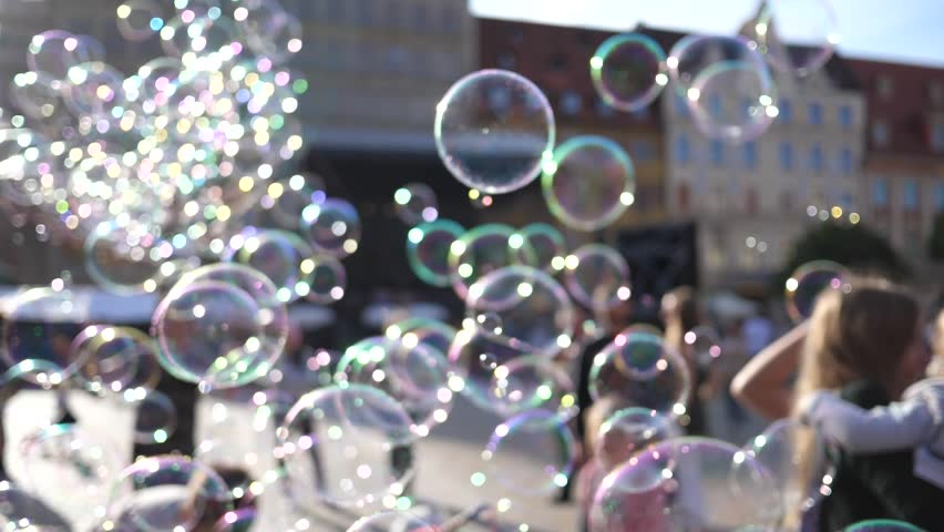 Huge amount of soap bubbles busker fly entertaining a city center tourists people walking in Wroclaw Poland   Shutterstock HD Video #1011507941