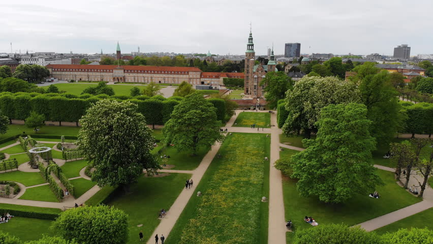 Aerial view of Rosenborg Castle (renaissance style palace) situated in The King's Garden (Kongens Have) - central Copenhagen, capital city of Denmark from above | Shutterstock HD Video #1011516221
