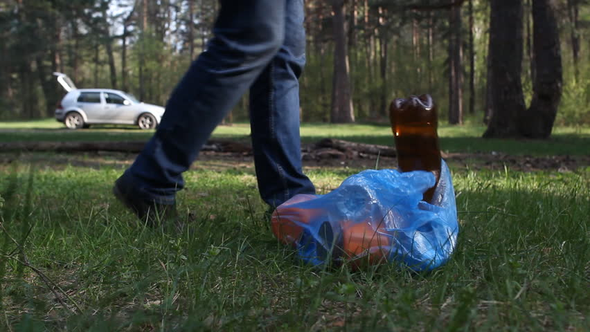 A man throws rubbish in the woods, close-up, trash | Shutterstock HD Video #1011549581