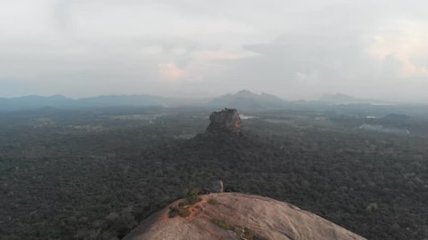 Aerial view flying backwards of Pidurangala and Sigiriya Rock, a must to see in Sri Lanka. Shot in 4k.
