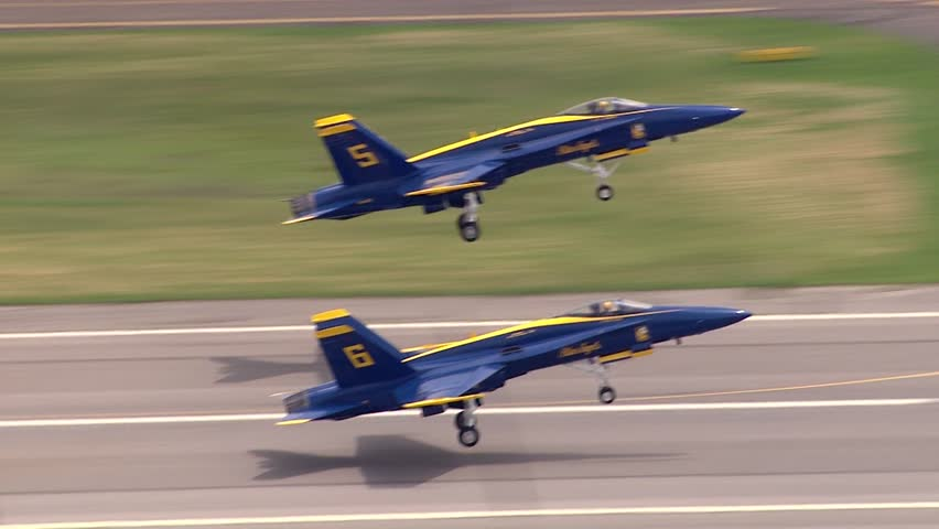 USA - Circa 2018: Blue Angels fighter jet F-18 aircraft close up takeoff from airport runway on clear summer day to airshow demonstration in formation