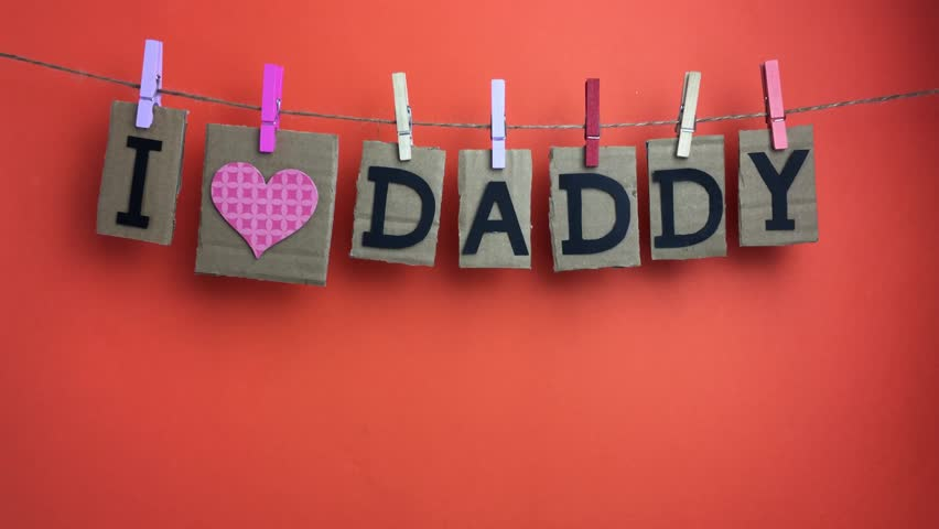 "Phrase ""I love Daddy"" on naranja background. 