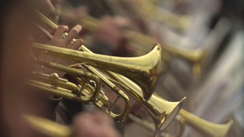Close-up of wind instruments. Jazzman plays the trumpet. Brass tool.