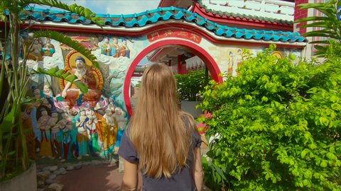 Slowmotion steadycam shot of family visiting a Kek Lok Si temple on Penang island, Malaysia