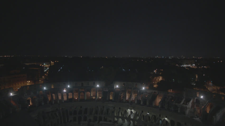 Aerial Drone footage view of Colosseum in Rome Italy by night // no video editing