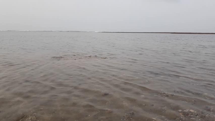 Clear water at Mul Dwarka Beach in Gujarat, India.
