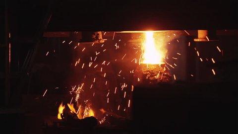 Smelting Furnace Sparks. Hot Steel Sparks From Industrial Furnace.