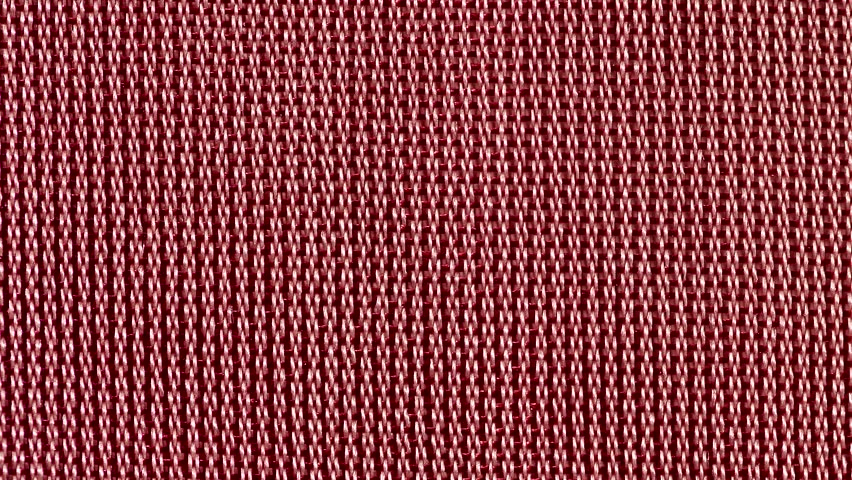 Left to right sliding  on a red fabric macro close up