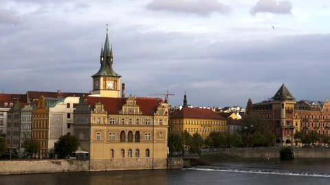 view of the old town waterworks on the riverfront of the vltava river from the charles bridge in prague, czech republic