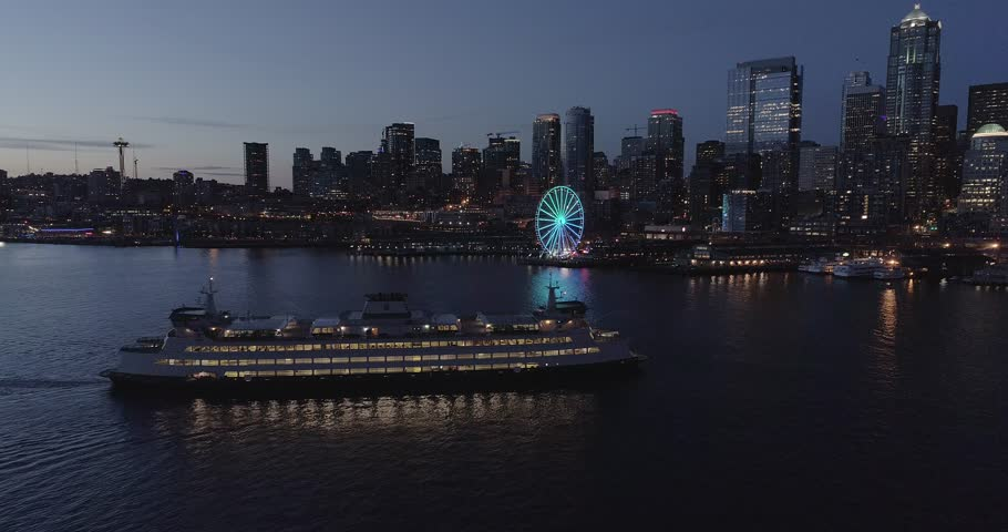 Sunset on the Seattle Skyline with a ferry passing by.