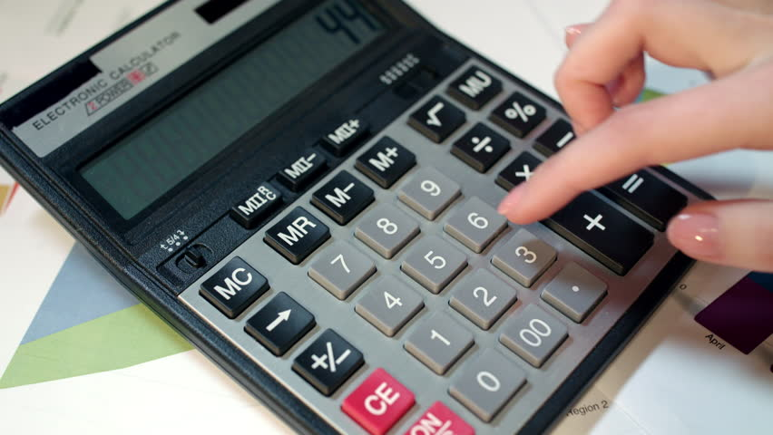 Woman using calculator. Business accounting and money profit calculation. Close up of business woman hand using calculator at office. Female accountant calculate numbers. Family budget calculation