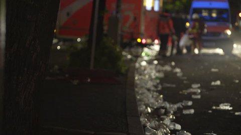 Ambulance emergency health service vehicle, doctor paramedics, filthy street