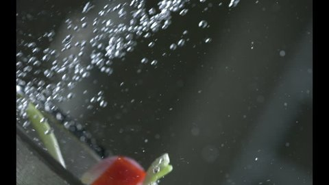 Appetizing vegetables are washed under running water in a colander. Slow motion. Very beautiful studio shot. Slow motion.