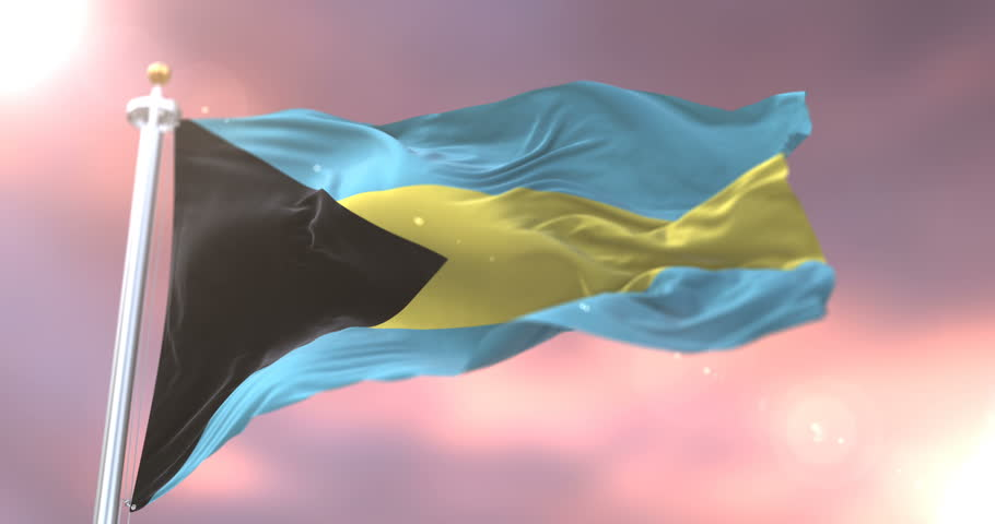 Bahamas flag waving at wind in slow at sunset, loop