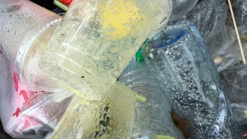 plastic garbage of used disposable food and drink containers, closeup #1012091171