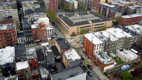 Aerial drone shot of Williamsburg district, New York City. Streets and crossroads, cloudy day. NYC, USA.