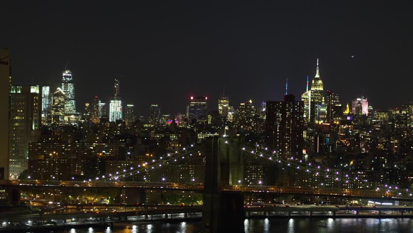Night Manhattan in New York, Financial District, Brooklyn Bridge / Cinematic Aerial shot on Inspire 2 / New York, US 05/29/2018   Shutterstock HD Video #1012151231
