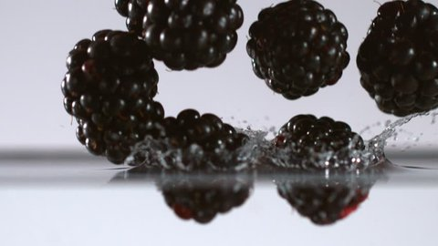 Blackberries falling into water in super slow motion. Shot with high speed cinema camera, 2000fps.