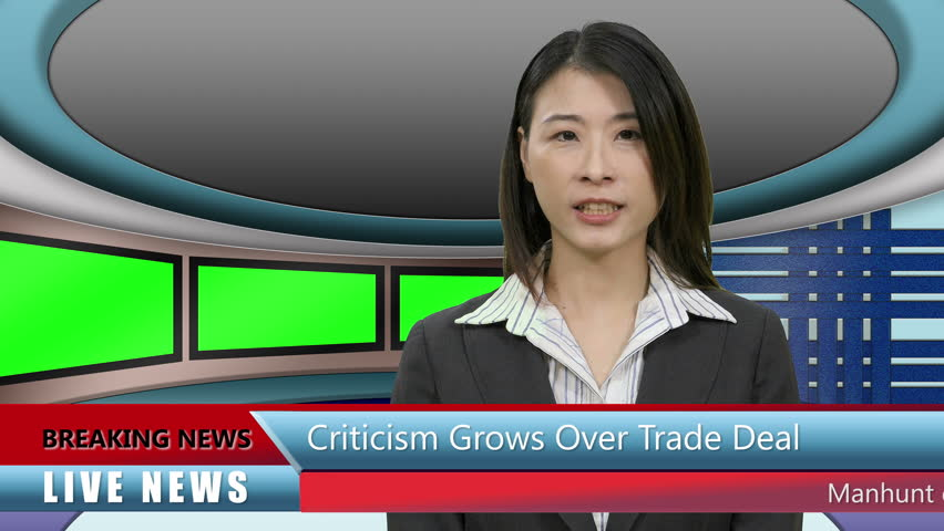 Asian TV News presenter in Television Studio with lower thirds and row of green screen monitors | Shutterstock HD Video #1012244351