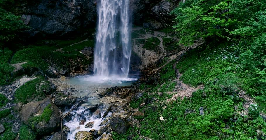 European man with beard is doing waterfall-meditation while standing under big waterfall in austria, wildensteiner waterfall #1012267031