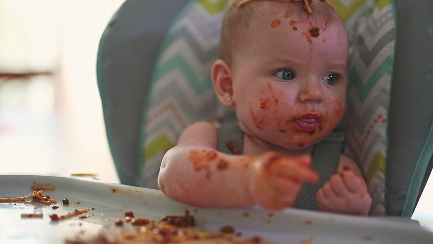 Little baby eating her dinner and making a mess | Shutterstock HD Video #1012276031