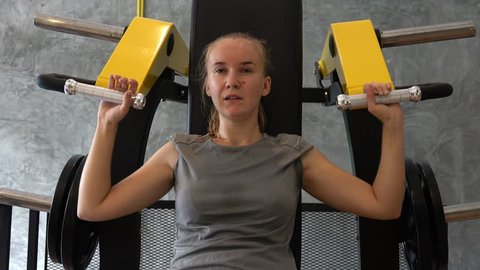Young Woman Can not Lift Weights in Gym. Challenge and Copability Concept
