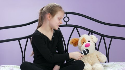 The Young Reporter Interviews With Her Plush Dog 02