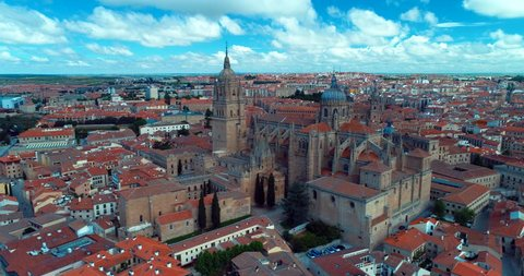The New Cathedra in Salamanca was constructed between the 16th and 18th centuries in two styles: late Gothic and Baroque. Building began in 1513 and the cathedral was consecrated in 1733 . aerial 4k