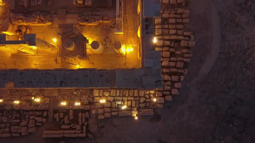 Overhead 4k drone shot of Athens Acropolis Parthenon. Illuminated at night. Aerial of famous temple