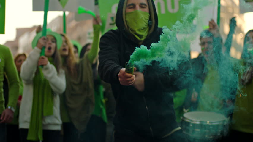 Protesters or soccer fans screaming, jumping and celebrating with smoke bomb . Shot on ARRI ALEXA in slow motion . #1012363451