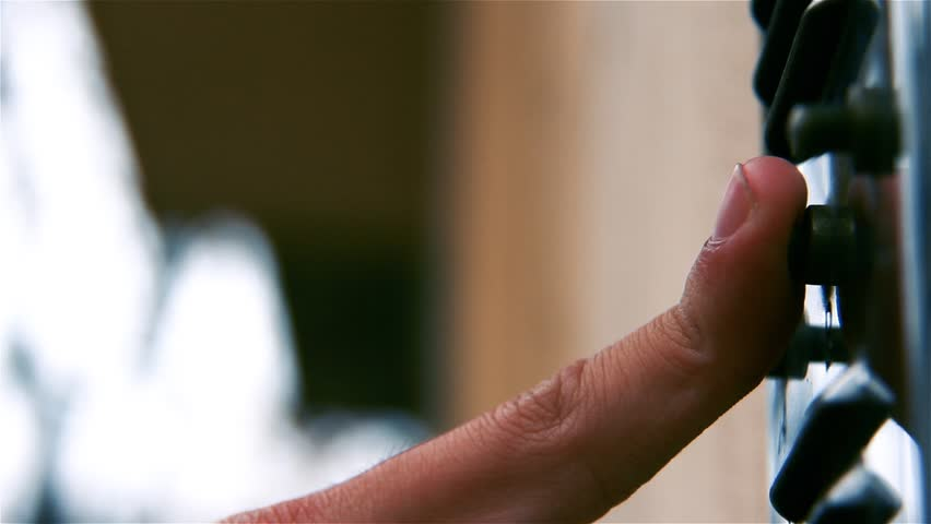 Hand of a Man Rings a Doorbell. Close-Up.