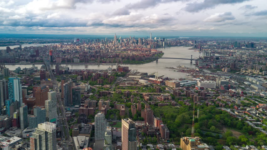 Aerial view of Brooklyn and Manhattan, New York City. Tall buildings. Sunny day, aerial timelapse. Clouds on background. | Shutterstock HD Video #1012402211