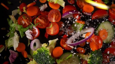 Fresh vegetables frozen in mid-air. Shooted in super slow motion