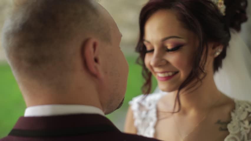 Lovely wedding couple. Portrait of Bride. She looks at groom | Shutterstock HD Video #1012519091