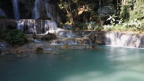 Kuang Si cascade waterfall, Laos, with turquoise colored pools.