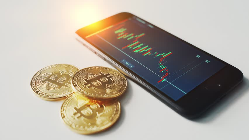 Btc bitcoin with stock market on smartphone | Shutterstock HD Video #1012558211