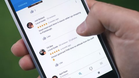 MONTREAL, CANADA - June 2018 :  reviews being browsed on a smartphone. Reading the comments of different customers before taking a decision.