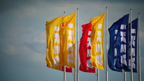 Malmo - Sweden - June - 20 - 2018   Ikea's flags in the wind against blue and cloudy sky.