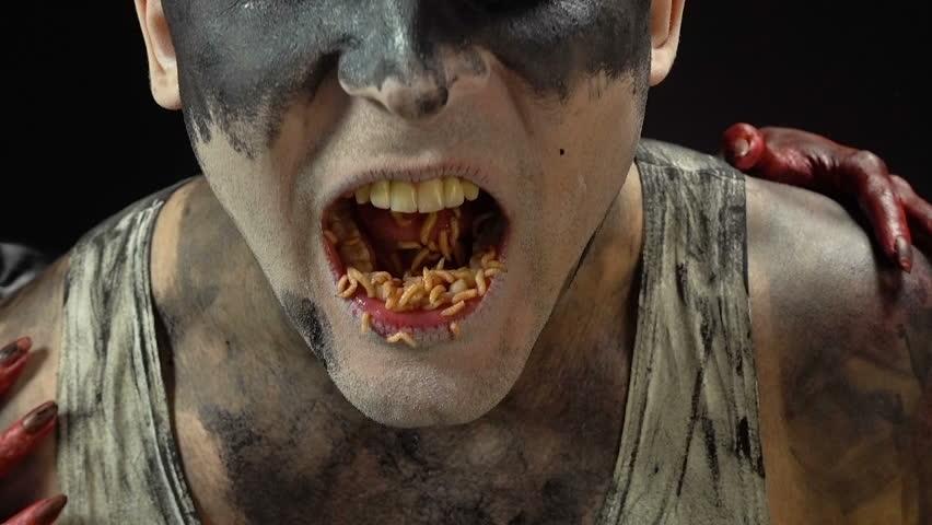 Madness man eating maggots