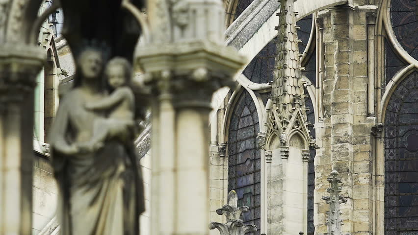 Notre-Dame de Paris exterior, beautiful statue of Virgin and Child, architecture | Shutterstock HD Video #1012663661