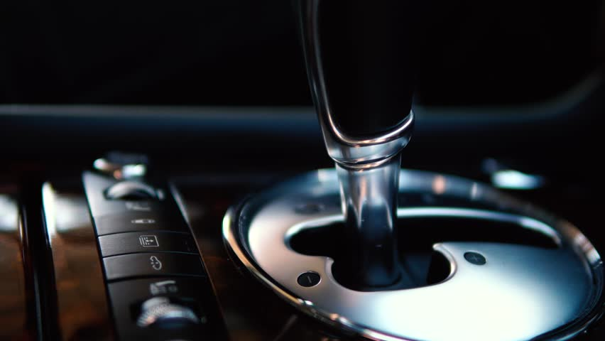 Car gear shifting close up. Automatic transmission. | Shutterstock HD Video #1012685021