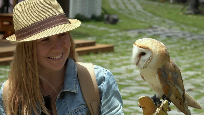 Female Tourist Posing for Photo with Barn Owl (Tyto alba) | Shutterstock HD Video #1012714571