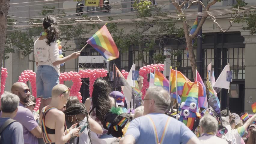 San Francisco, CA / USA - June 24 2018:  San Francisco Pride Parade 2018, crowd on Market Street. 48th annual SF Pride parade, Generations of Strength, celebrates diversity.
