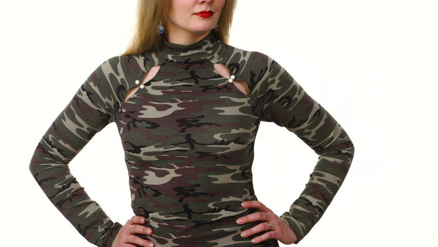 Woman wearing fashionable green blouse stylish camo pattern top, model presenting clothing on white. Fashion concept.