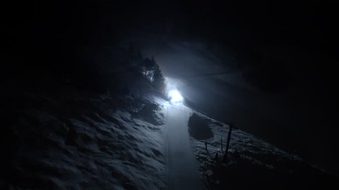 Snow Grooming on Aspen Mountain for Skiing and Snowboarding at Night in the Evening Aerial Drone Shot